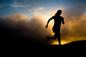 Silhouetted Woman Running at Sunset