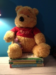 Winnie the Pooh (and Piglet) and the books my sister used to read us. Photo by Suzanne Vince